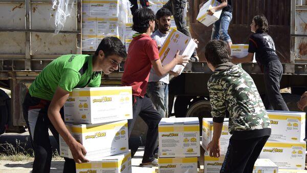 Rozładunek pomocy humanitarnej w Syrii - Sputnik Polska