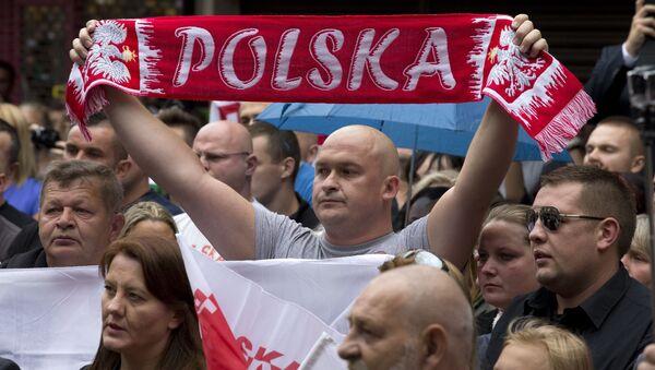 Marsz Milczenia upamiętniający pobitego na śmierć Arkadiusza Jóźwika. Harlow. Wielka Brytania - Sputnik Polska