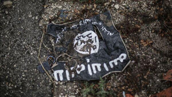 Flaga radykalnej organizacji islamistycznej ISIS - Sputnik Polska