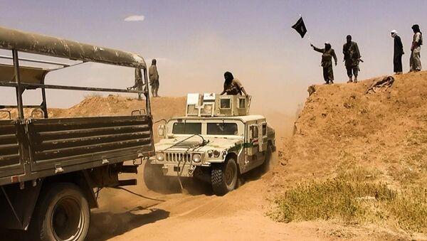 Bojownicy ISIS na granicy Syrii i Iraku - Sputnik Polska
