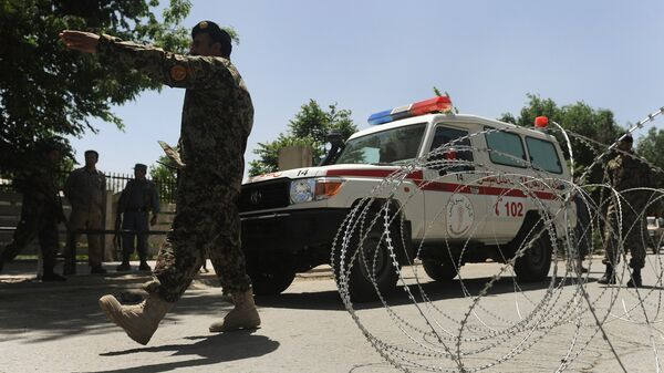 Wojskowi i karetka pogotowia w Afganistanie - Sputnik Polska