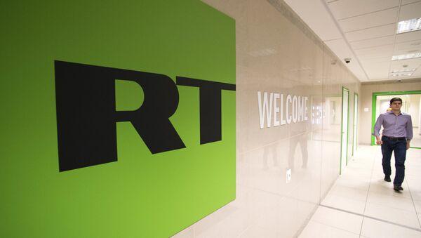 Russia Today logo - Sputnik Polska