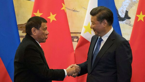 Prezydent Filipin Rodrigo Duterte przyjechał z oficjalną wizytą do Chin na zaproszenie przewodniczącego ChRL Xi Jinpinga - Sputnik Polska