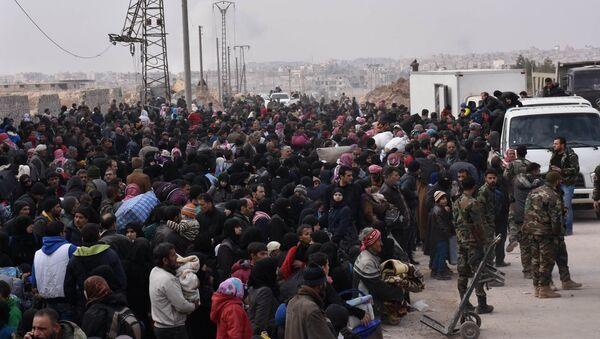 Ewakuacja Syryjczyków ze wschodnich dzielnic Aleppo - Sputnik Polska