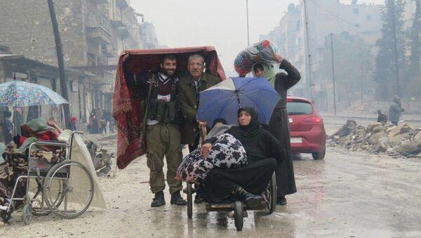 Mieszkańcy wschodniego Aleppo. - Sputnik Polska