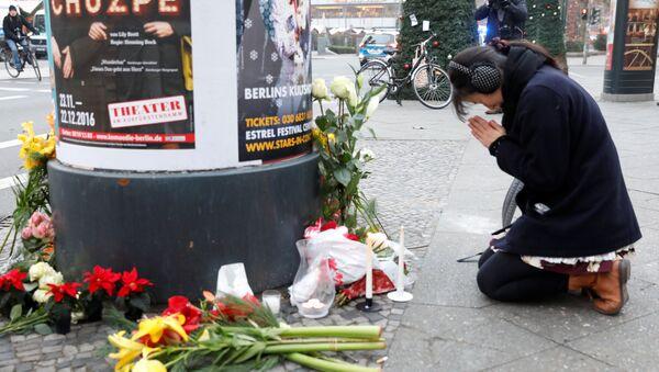Gedenken der Opfer der Tragödie auf Berliner Weihnachtsmarkt - Sputnik Polska