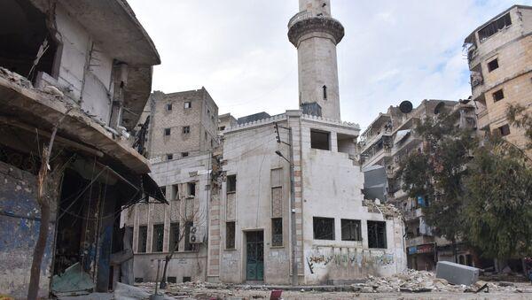 Zniszczone budynki w wyzwolonym Aleppo - Sputnik Polska