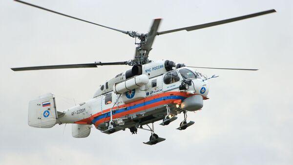 Lot pokazowy śmigłowca Ka-32A11VS podczas ceremonii otwarcia Międzynarodowego Salonu Kompleksowe Bezpieczeństwo 2016 w Noginsku - Sputnik Polska