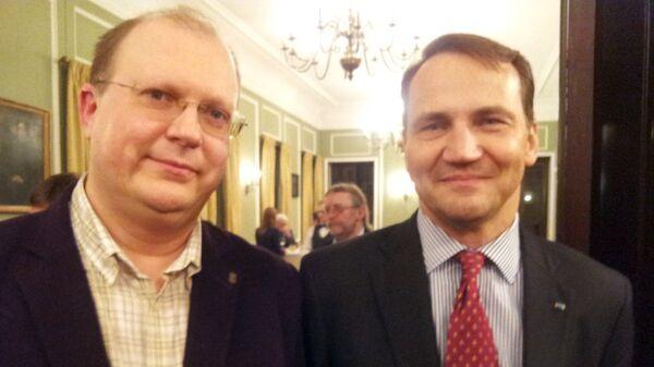Były minister spraw zagranicznych Radosław Sikorski i dziennikarz Rossiya segodnya Leonid Swiridow - Sputnik Polska