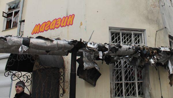 Магазин, пострадавший в результате обстрела украинскими силовиками, в Донецке - Sputnik Polska