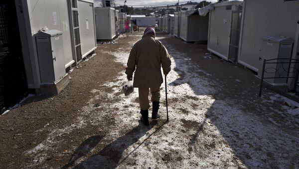 Syryjski uchodźca w obozie dla uchodźców na północ od Aten - Sputnik Polska