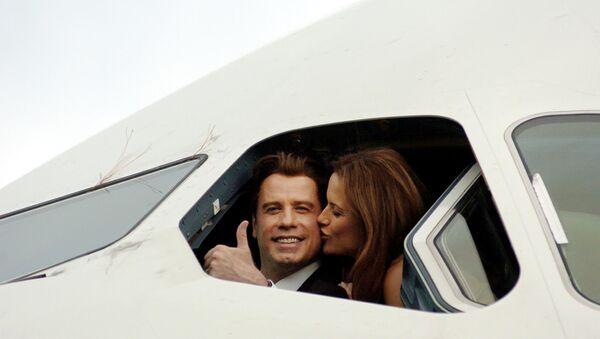 John Travolta z żoną - Sputnik Polska