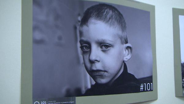 Twarze dzieci wojny: Berlińska wystawa fotograficzna o walkach w Donbasie - Sputnik Polska
