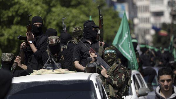 Członkowie Hamasu podczas pogrzebu Mazena Faqha w Gazie - Sputnik Polska