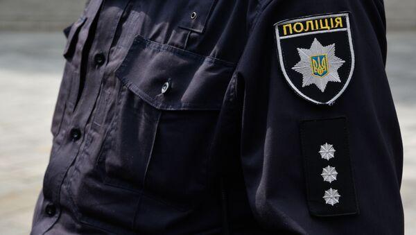 Pracownik ukraińskiej policji w Kijowie - Sputnik Polska