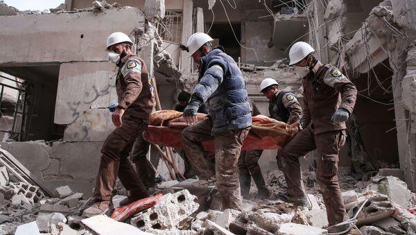 Białe hełmy na przedmieściach Damaszku - Sputnik Polska