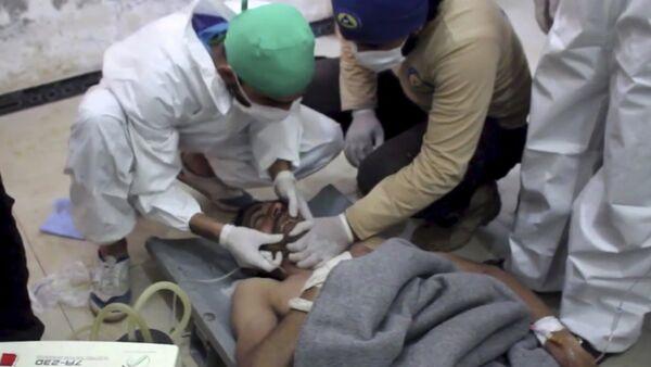 Okazanie pomocy ofiarom ataki chemucznej w Khan Sheikhoun, prowincja Idlib, Syria - Sputnik Polska