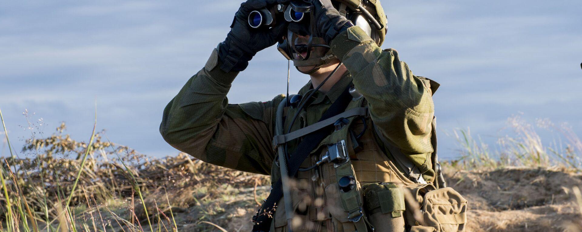 Żołnierz podczas ćwiczeń NATO Saber Strike. Zdjęcia archiwalne - Sputnik Polska, 1920, 03.09.2021