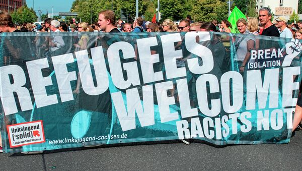 Akcja zwolenników przyjęcia uchodźców - Sputnik Polska
