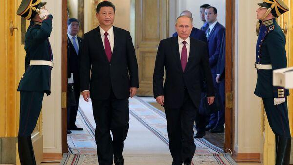 Prezydent Rosji Władimir Putin i Przewodniczący ChRL Xi Jinping - Sputnik Polska