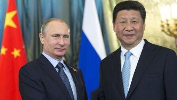Prezydent Rosji Władimir Putin i przewodniczący ChRL Xi Jinping na Kremlu - Sputnik Polska