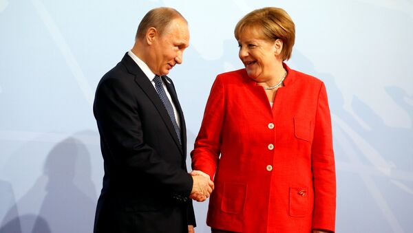 Angela Merkel i Władimir Putin - Sputnik Polska