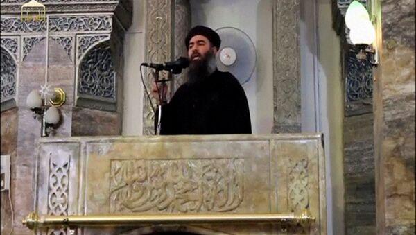 Domniemany przywódca zakazanej w Rosji organizacji terrorystycznej Daesh Abu Bakr al-Baghdadi - Sputnik Polska