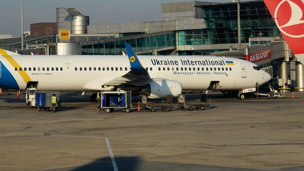 Samolot Boeing 737-900EA linii lotniczych Ukraine International Airlines (UIA) - Sputnik Polska