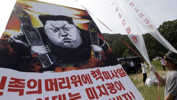 Karykatura na temat prób rakietowych Kim Dzong Una - Sputnik Polska