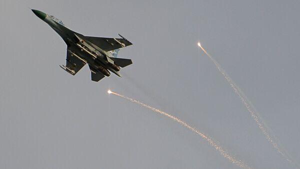 Myśliwiec ukraińskiej armii na niebie nad Ługańskiem. Zdjęcie archiwalne - Sputnik Polska