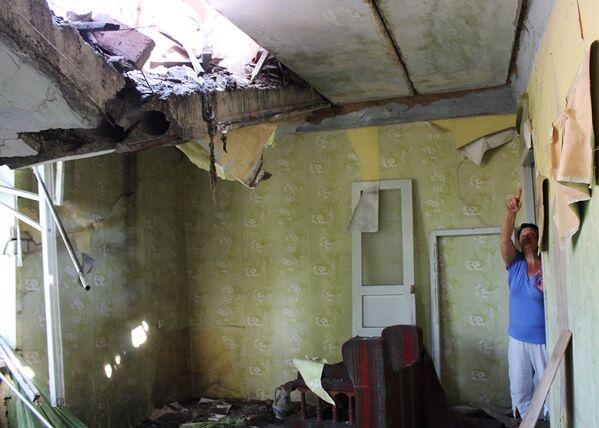 Zniszczone ostrzałem mieszkanie - Sputnik Polska