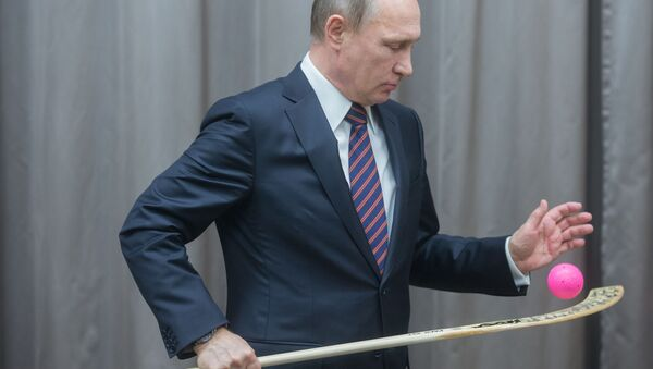 Władimir Putin na spotkaniu z reprezentacją Rosji w hokeju - Sputnik Polska
