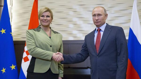 Prezydent Republiki Chorwacji Kolinda Grabar-Kitarovic i prezydent Rosji Władimir Putin na spotkaniu w Soczi - Sputnik Polska