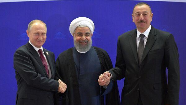 Władimir Putin, Hasan Rouhani i Ilham Alijew - Sputnik Polska