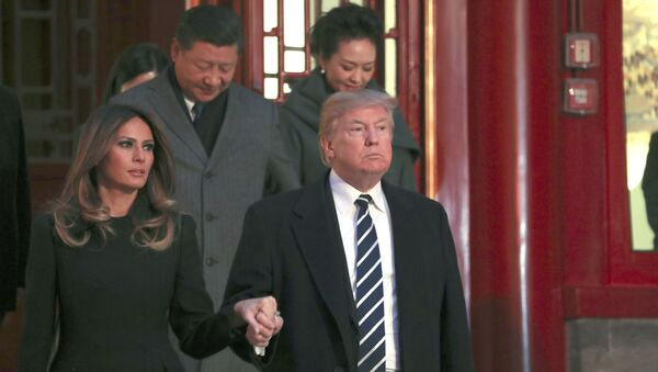 Donald Trump z żoną Melanią w Pekinie - Sputnik Polska