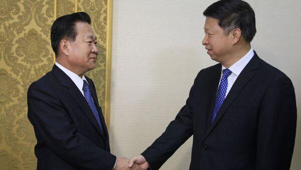 Wiceprzewodniczący Centralnego Komitetu Partii Pracy Korei Choe Ryong Hae i szef Wydziału Łączności Międzynarodowej Komitetu Centralnego Komunistycznej Partii Chin Song Tao - Sputnik Polska