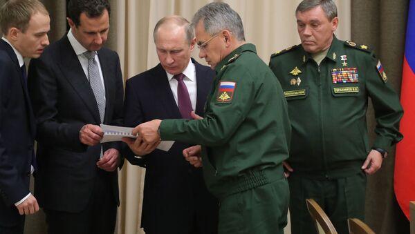 Władimir Putin i Baszar al-Asad podczas spotkania w Soczi - Sputnik Polska
