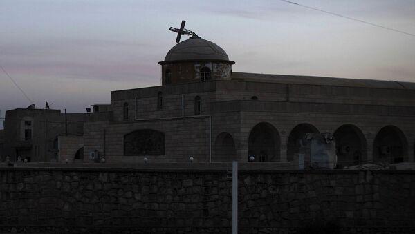 Zniszczony przez terrorystów kościół w okolicach Mosulu - Sputnik Polska