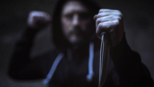 Mężczyzna z nożem - Sputnik Polska