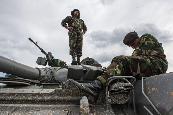 Żołnierz sił zbrojnych Nikaragui na poligonie w Ałabinie w obwodzie moskiewskim, gdzie odbywają się wyścigi treningowe w ramach Wojskowych Igrzysk Międzynarodowych - 2015 - Sputnik Polska