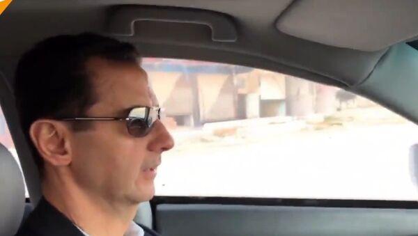 Baszar Asad w samochodzie - Sputnik Polska