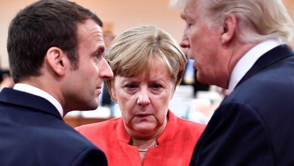 Kanclerz Niemiec Angela Merkel, prezydent USA Donald Trump i prezydent Francji Emmanuel Macron - Sputnik Polska