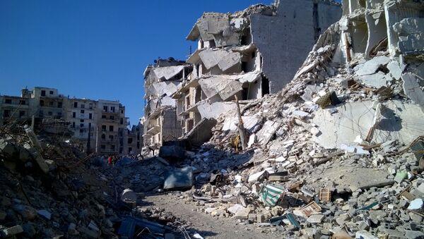 Zniszczone domy w wyzwolonym obszarze Al Soukari w Aleppo - Sputnik Polska