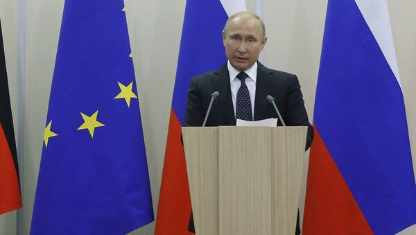 Władimir Putin i Angela Merkel - Sputnik Polska