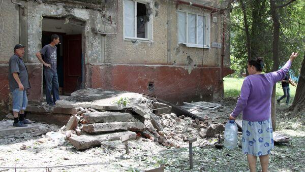 Konsekwencje ostrzału miejscowości w Donbasie przez ukraińskie siły bezpieczeństwa - Sputnik Polska