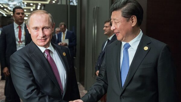 Prezydent Rosji Władimir Putin i przewodniczący Chin Xi Jinping - Sputnik Polska