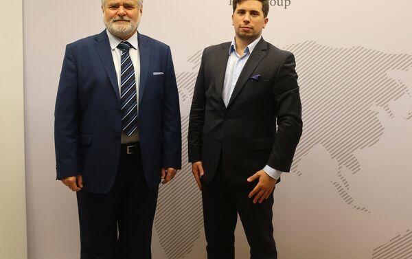 Kierownik biura PAIH w Moskwie Wojciech Kolignan i project manager Dawid Cecuda - Sputnik Polska