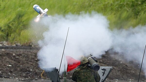 Strzelanie podczas ćwiczeń wojskowych w Japonii - Sputnik Polska