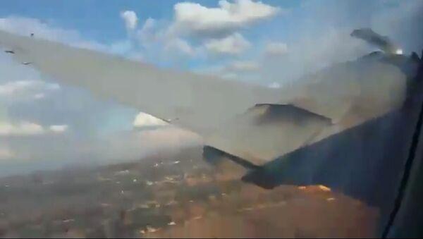Stopklatka z wideo nagranego przez pasażera podczas upadku samolotu w RPA - Sputnik Polska
