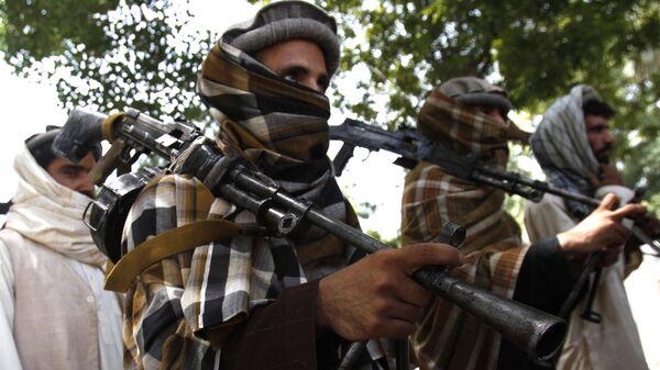 Afgańscy Talibowie z bronią. Zdjęcie archiwalne - Sputnik Polska